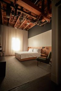 A bed or beds in a room at The Premier Mill Hotel