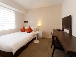 Cama o camas de una habitación en Hotel Keihan Tokyo Yotsuya
