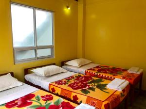 A bed or beds in a room at Sin Yaw Guesthouse