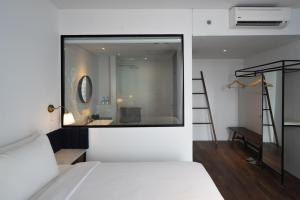 A bed or beds in a room at Park 5 Cilandak