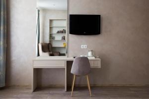 Télévision ou salle de divertissement dans l'établissement Grand Mark by ACADEMIA