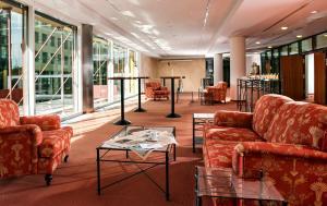 Ein Sitzbereich in der Unterkunft Hotel Elbflorenz Dresden