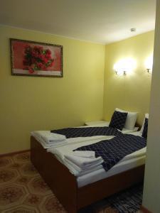 Кровать или кровати в номере Мини-гостиница Пелысь