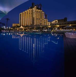 The swimming pool at or near Babylon Rotana Hotel