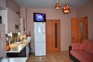 Телевизор и/или развлекательный центр в Reddly House