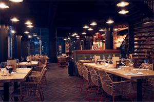 A restaurant or other place to eat at Inntel Hotels Utrecht Centre