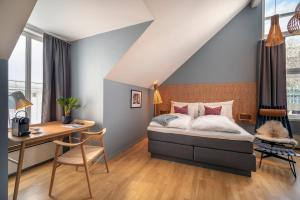 A bed or beds in a room at Molde Fjordstuer - by Classic Norway Hotels