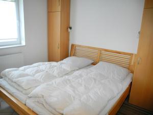 Ein Bett oder Betten in einem Zimmer der Unterkunft Ferienhaus Krabbe in Friedrichskoog-Spitze/ Nordsee