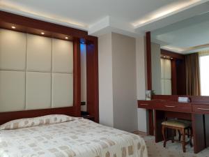 Кровать или кровати в номере National Palace Spa & Wellness Hotel