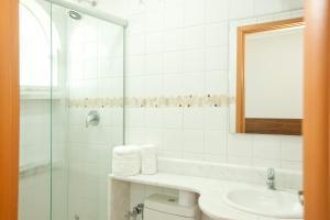 Um banheiro em Hotel Colonial Plaza