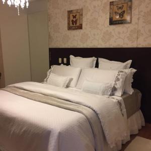 Cama ou camas em um quarto em Pousada Villa Guimaraes