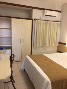 Cama ou camas em um quarto em Portal da Princesa Hotel