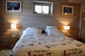 A bed or beds in a room at Chambre d'Hôtes La Maisonnette