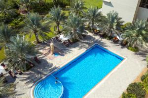 A view of the pool at Centro Sharjah - by Rotana or nearby