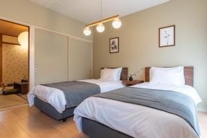 Bijou Suites Prestigeにあるベッド