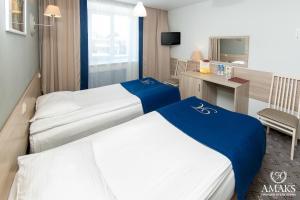 Кровать или кровати в номере АМАКС Премьер-отель