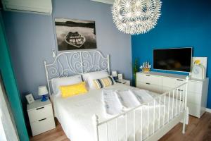 A bed or beds in a room at Aegean Family Apartment