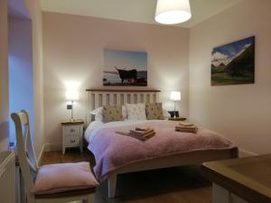 Postel nebo postele na pokoji v ubytování Ewich House B&B