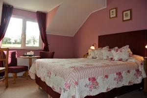 Un ou plusieurs lits dans un hébergement de l'établissement Drumcreehy Country House B&B