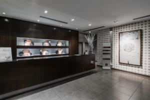 The lobby or reception area at Max Hotel Livorno
