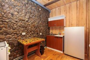 A kitchen or kitchenette at Gutsulska Oselya