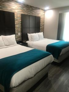 A bed or beds in a room at Hotel Nirvana