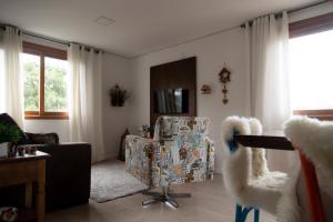 Uma área de estar em Apartamento em Gramado