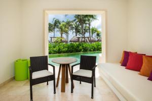 A seating area at Secrets Akumal Riviera Maya - Adults Only
