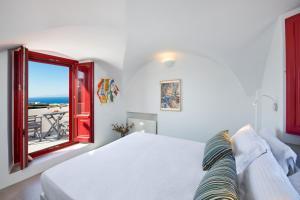 Un ou plusieurs lits dans un hébergement de l'établissement Aplada Suites