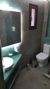 A bathroom at Antonia Apartments