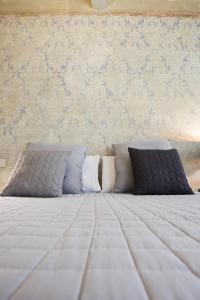Cama ou camas em um quarto em Il Piccolo Cavour Charming House