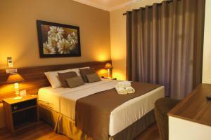 Cama ou camas em um quarto em Pousada Le Sapê