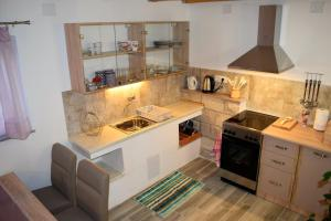 A kitchen or kitchenette at Veritas Apartments