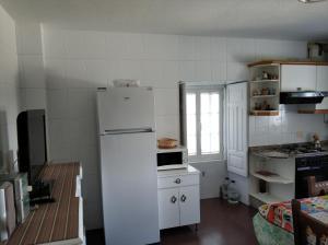 A kitchen or kitchenette at PRECIOSA CASA DE 4 HABITACIONES EN PLENO CORAZÓN DEL CAMINO DE SANTIAGO!