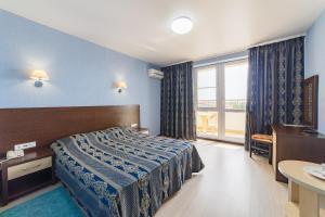 Кровать или кровати в номере Hotel Relax