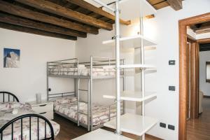 En eller flere køjesenge i et værelse på Residence Villa Vinco