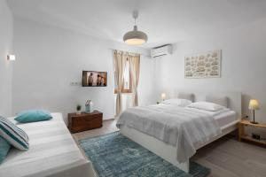 A bed or beds in a room at Old Town Rovinj Apartments by Irundo