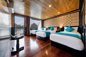 A bed or beds in a room at Halong Serenity Cruises