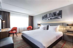 A bed or beds in a room at Ramada by Wyndham Amsterdam Airport Schiphol