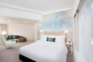 A bed or beds in a room at OZO Wesley Hong Kong