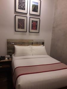 Кровать или кровати в номере The Bricks Hotel