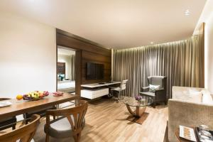 A seating area at Grand Chennai by GRT Hotels