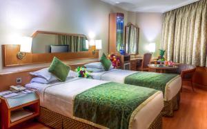Cama ou camas em um quarto em Jeddah Trident Hotel