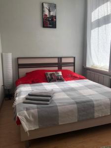 Кровать или кровати в номере ЛОН-ДОН 2