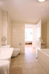 Ein Badezimmer in der Unterkunft Ferienwohnung Alpenrose
