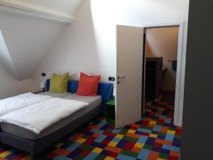 A bed or beds in a room at FunKey Hotel