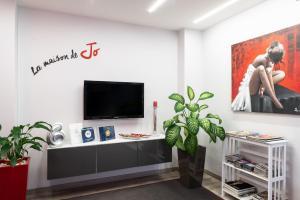 TV o dispositivi per l'intrattenimento presso B&B La Maison de Jo