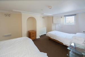 A bed or beds in a room at Welcoming Flat