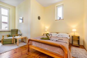 Łóżko lub łóżka w pokoju w obiekcie Apartament Hektor Home