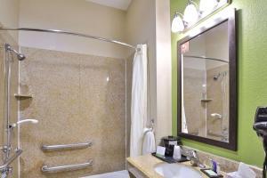 A bathroom at Sleep Inn & Suites University